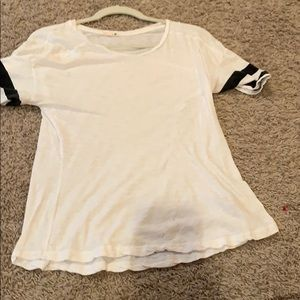 white t-shirt with black stripes on sleeves